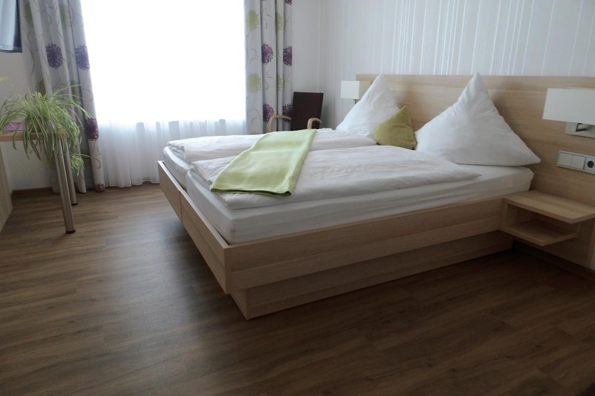 Doppelzimmer Grauburgunder Schlafbereich